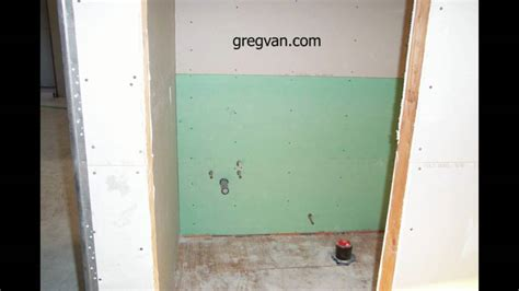 green board in bathroom green wallboard behind toilet and bathroom cabinet home