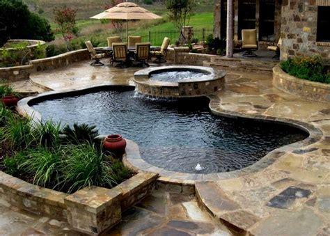 Freeforms with flagstone decking   Tropical   Pool   other