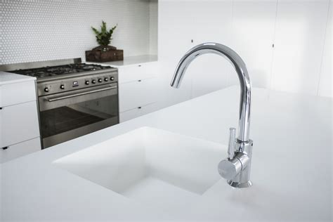 corian glacier white glacier white corian solid surface enhances family kitchen