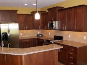 kitchen backsplash cherry cabinets photos of cherry cabinets and white granite counters