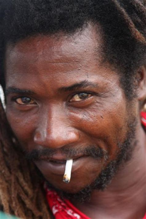 pictures of jamaican men jamaican smoking a joint in the kingston market jamaican