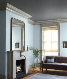 the colored ceiling and light grey trim takes this baby blue room from sweet to