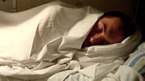 man in bed good night s sleep may be critical for brain health