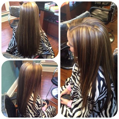 lowlighting the hair under the top layer underneath layer of deep chocolatey brown and top with