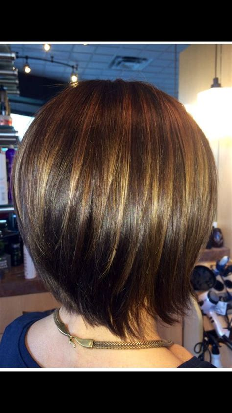 dark hair with graduated layers graduated bob with caramel highlights to compliment her