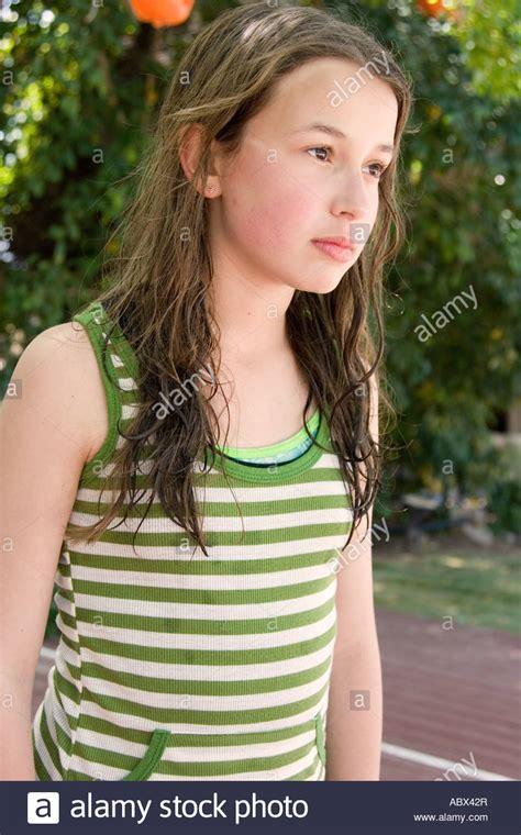 12 yo girl model stock photo of 12yo girl posing for camera stock photo