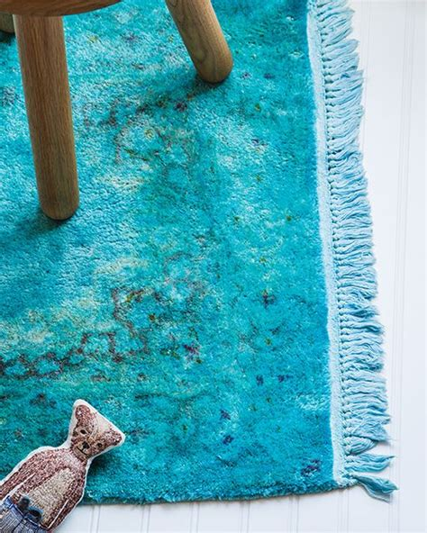 rug that turns when use fabric dye to easily turn a drab rug into a fashionable and bright overdyed rug home