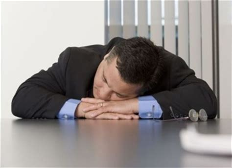 Picture Of Someone Sleeping At Their Desk by Sleeping Desk Media