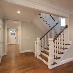 U Stairs Design The Beautiful U Shaped Stair Has Hardwood Treads And Handrails With Painted White Risers Newel