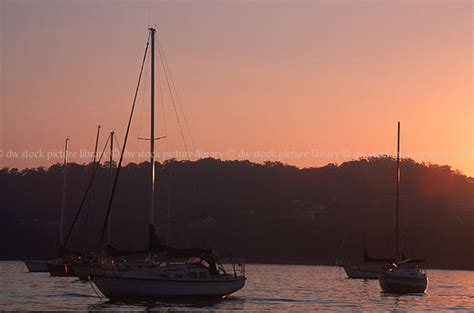 boat mooring south wales sunset over water and moored yachts gosford nsw australia