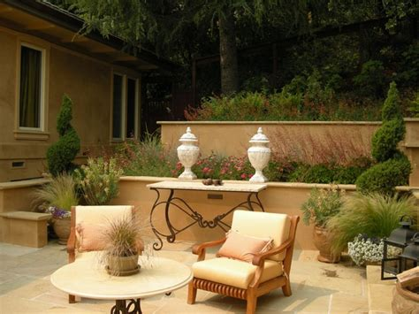 tiered stucco walls and terrace mediterranean patio