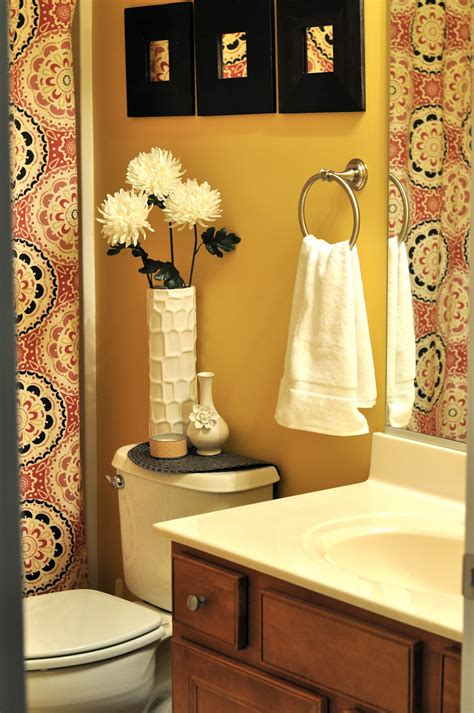 decorating ideas for a bathroom marvelous yellow wall paint of bathroom idea feat white toilet units and sweet flower