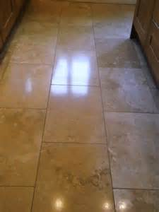 restoring the shine on a travertine floor tiles in
