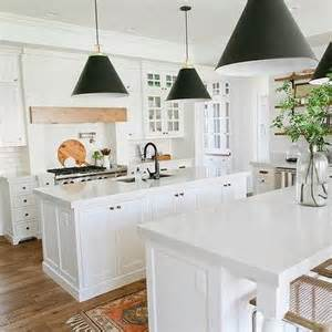 white kitchen island with black cone pendants transitional kitchen benjamin moore snowbound