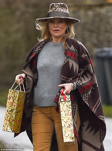 Send Flowers To Kate Moss And Feature In A V Magazine Shoot by Boho Kate Moss Delivers Festive Gifts To Neighbours