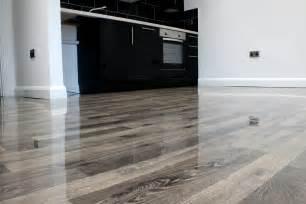 floorless floors supplies ivory high gloss laminate to