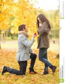 Holidays love couple relationship and dating concept kneeled men