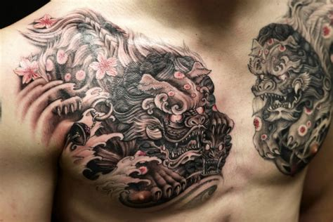rip chest tattoos superb black and grey colored foo dogs ripped skin