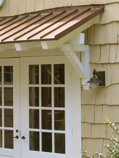 standing seam metal roof  rafters  brackets red