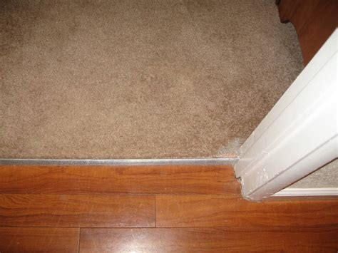 Where Transition From Laminate To Carpet - carpet to tile transition on concrete floor tile design