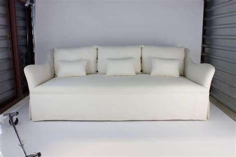 cream linen sofa custom fabricated sofa with six loose back cushions in