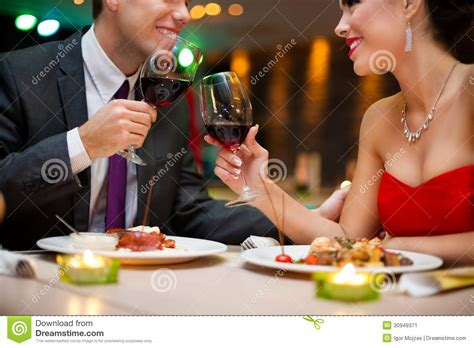 romantic couple drinking wine attractive young couple drinking red wine in restaurant