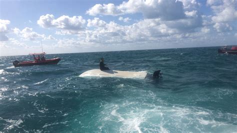 boat capsized 2 men rescued after boat capsizes near crandon park marina