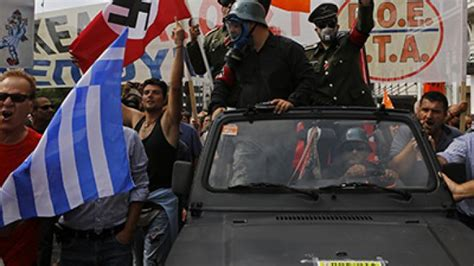athens police fire tear gas in crackdown clashes at anti