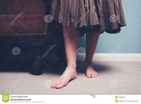 6 Foot Sofa barefoot woman standing by sofa stock photo image 44868817