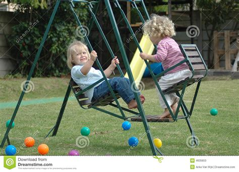 kid swings kids on swing stock image image of children barefoot
