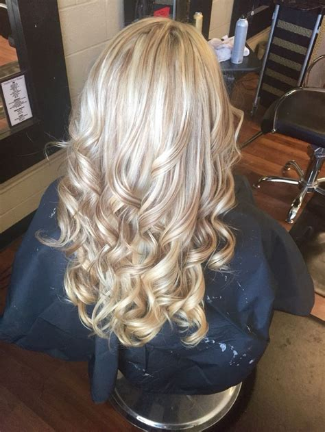 caramel and platinum hair color all over blonde with carmel blonde lowlights hair by