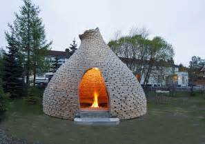 fireplace shelter made from recycled scrap wood wave avenue