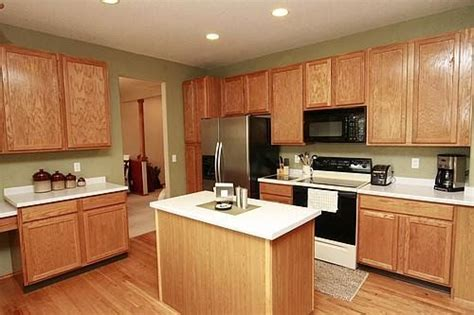 green paint with oak cabinets kitchen