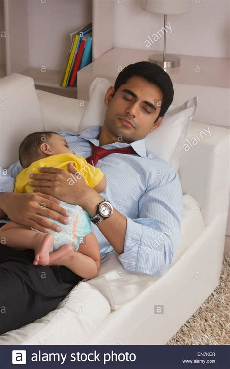 sleeping on sofa with newborn and baby sleeping on sofa stock photo royalty free