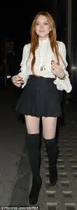 lindsay lohan wears a miniskirt for another night of