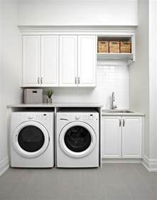 White Cabinets For Laundry Room White Modern Laundry Room Features Raised Panel Cabinets An Enclosed Washer And Dryer Next