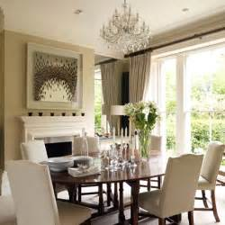 Classic neutral dining room with mahogany furniture tableware