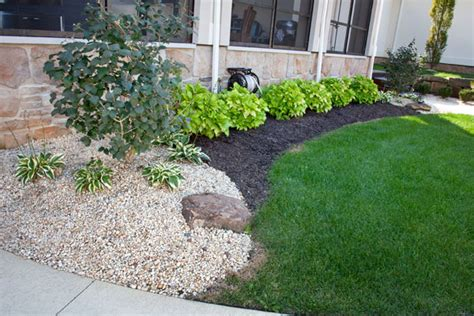 Landscaping With Rocks And Gravel Klein S Lawn Landscaping Landscapes Designed Landscapes