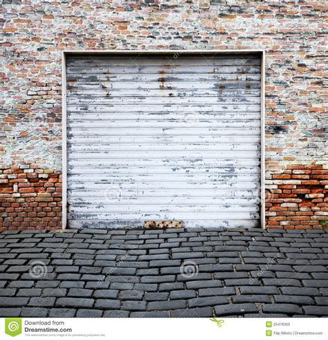Metal Up And Garage Doors by Roll Up Garage Door On Brick Wall Stock Photo Image