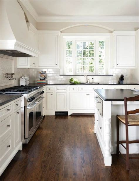 white kitchen cabinets with dark hardwood floors dark floors white walls pinterest addict
