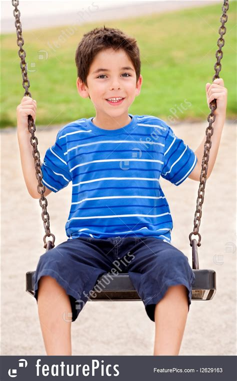 kid swing picture of kid enjoying swing ride