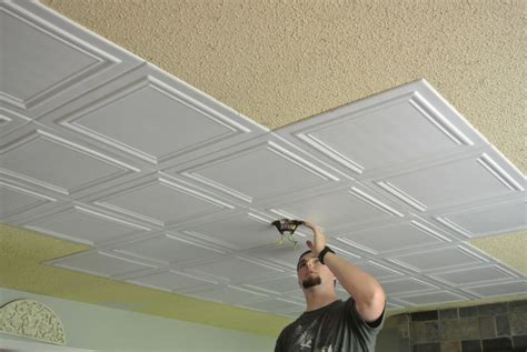 Fixing A In The Ceiling by Apply Lightweight Tile As A Diy Fix For 80s Popcorn