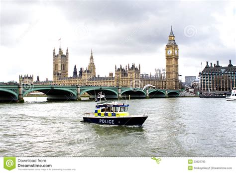 thames river cruise length police boat on the river thames outside parliment