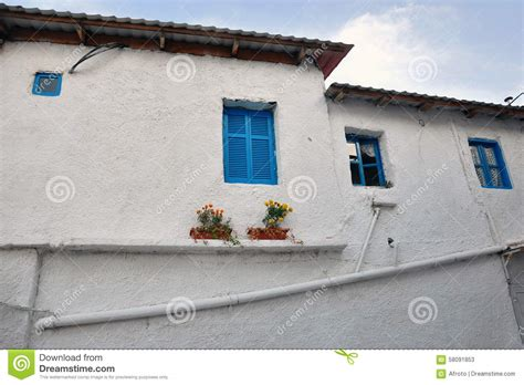 blue house with a blue window white house with blue windows stock photo image 58091853
