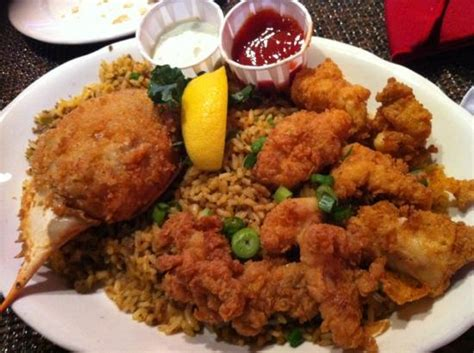 fried alligator and stuffed crab with rice