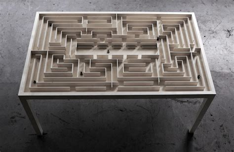 a wooden coffee table with a magnetic maze fubiz media