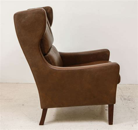 high back leather lounge chair in the style of