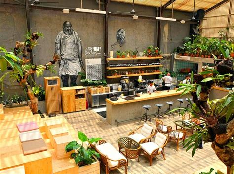 buns restaurant  jakarta offers lung pleasing greenhouse style dining inhabitat