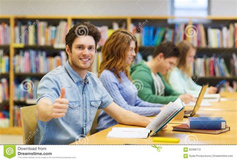 thumbs up my brown boy books happy student boy preparing to in library stock photo