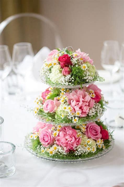etagere blumen center with flowers arreglos florales